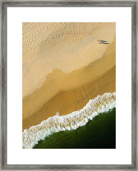 A Walk On The Beach. A Kite Aerial Photograph. Framed Print