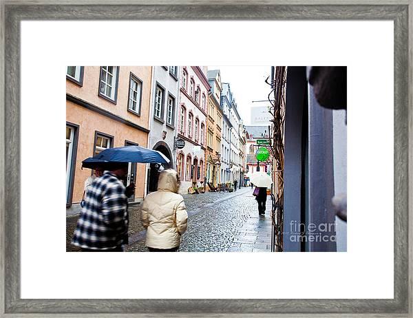 A Wet Walk Framed Print