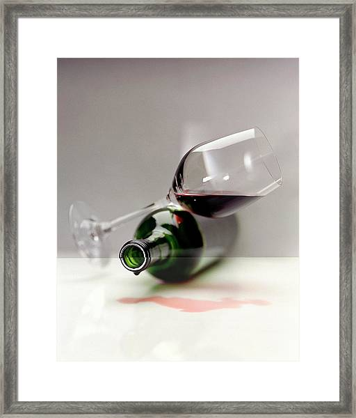 A Wine Bottle And A Glass Of Wine Framed Print