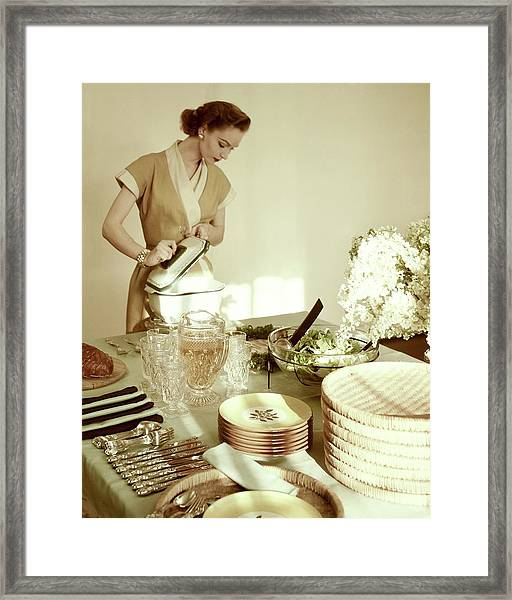 A Woman At A Dining Table Framed Print