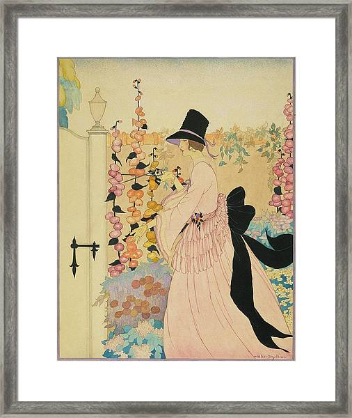 A Woman Cutting Flowers In A Garden Framed Print