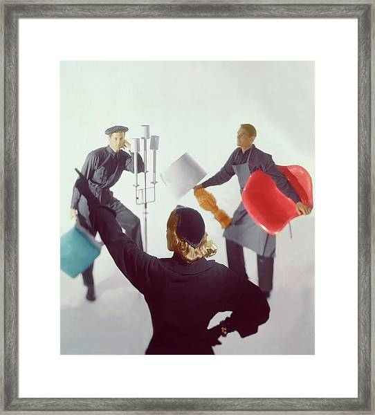 A Woman Directing Two Men With Props Framed Print
