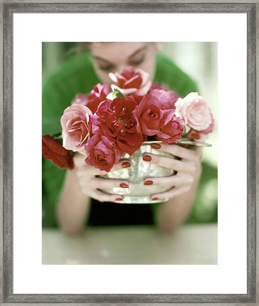 A Woman Holding A Bowl Of Roses Framed Print