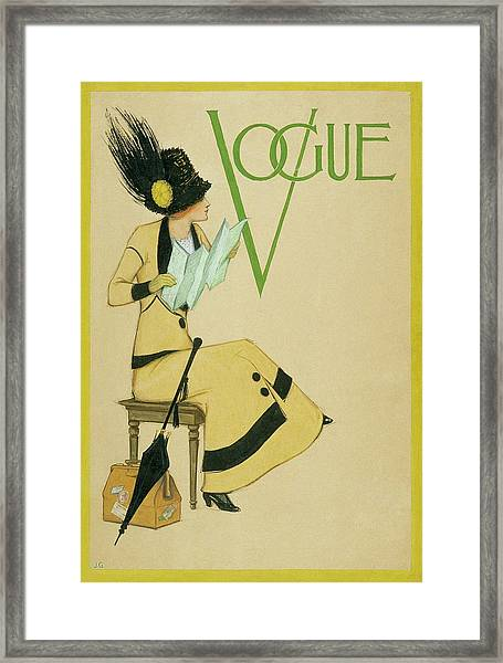 A Woman Holding A Map For Vogue Framed Print