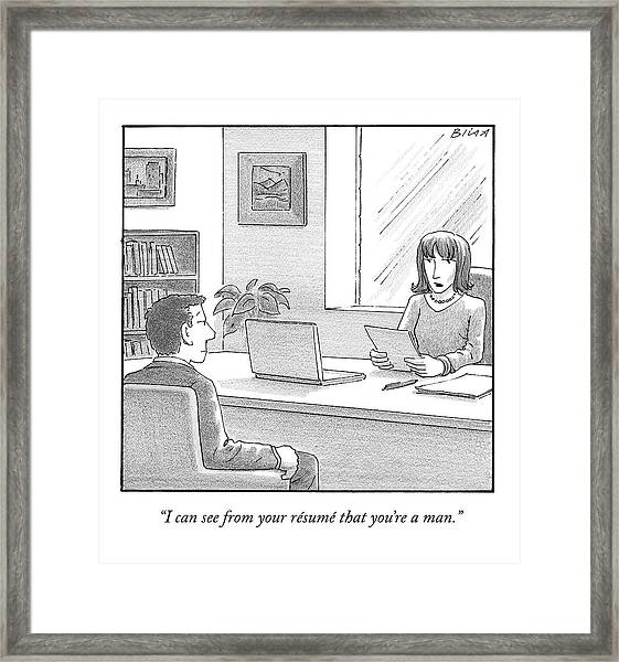 A Woman Interviewing A Man Reads His Resume Framed Print