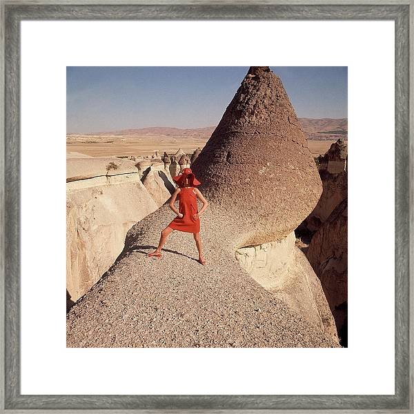 A Woman Modeling A Red Dress In Goreme Framed Print