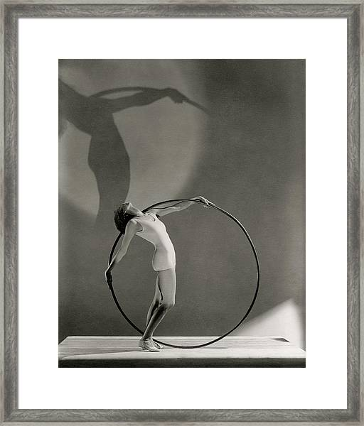 A Woman Posing With A Hula Hoop Framed Print