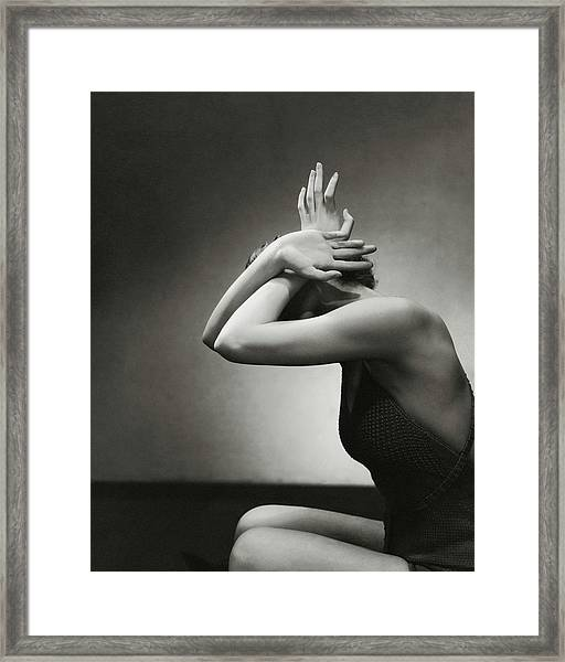 A Woman Shielding Her Head Framed Print