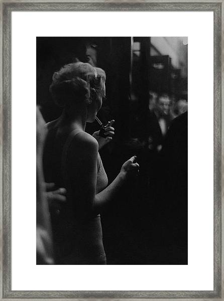 A Woman Smoking At The Music Box Framed Print