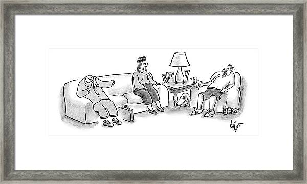 A Woman Speaks To Her Husband Who Is Sitting Framed Print
