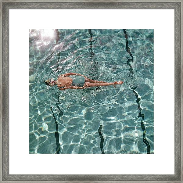 A Woman Swimming In A Pool Framed Print
