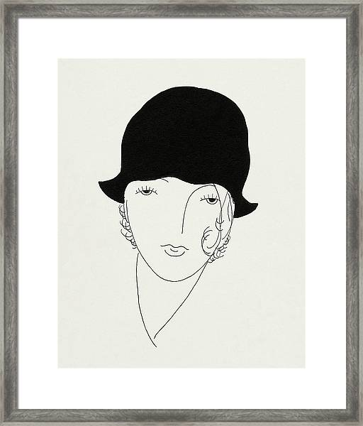 A Woman Wearing A Poorly Fitted Hat Framed Print