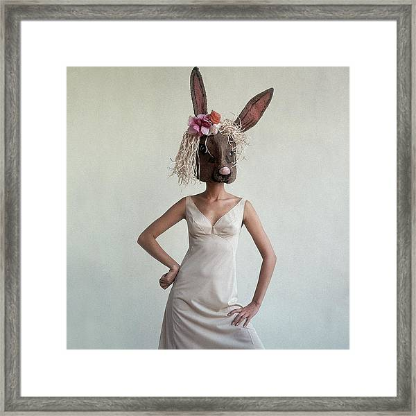 A Woman Wearing A Rabbit Mask Framed Print