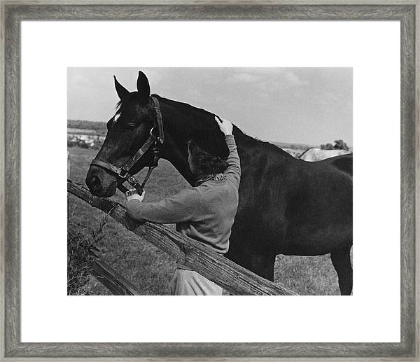 A Woman With A Horse Framed Print