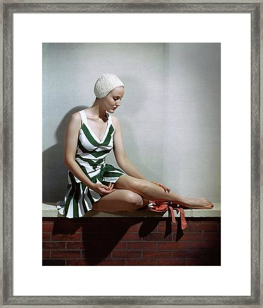 A Women In A Bathing Suit Framed Print