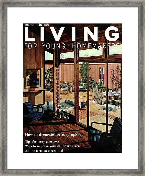 A Wood Paneled Living Room Framed Print