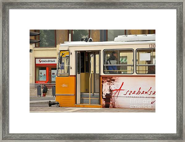 A Yellow Tram On The Streets Of Budapest Hungary Framed Print