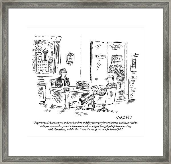 A Young Job Applicant Sits In Front Framed Print