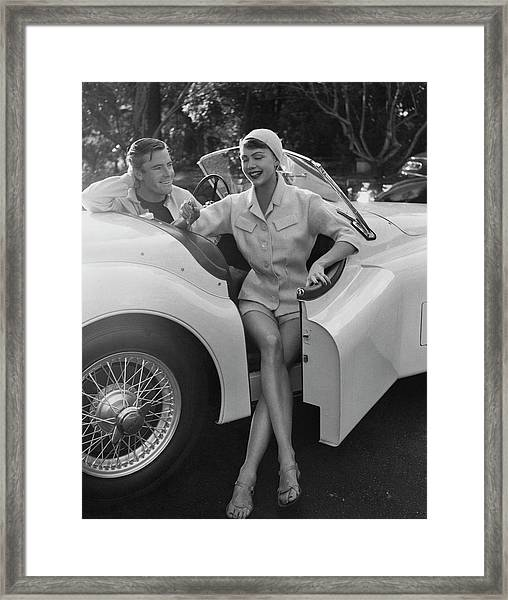 A Young Model Sitting In A Convertible Sports Car Framed Print