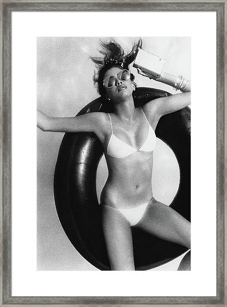 Debbie Dickinson Floating On An Inner Tube Framed Print