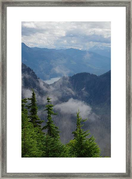 Above The Cloud Framed Print