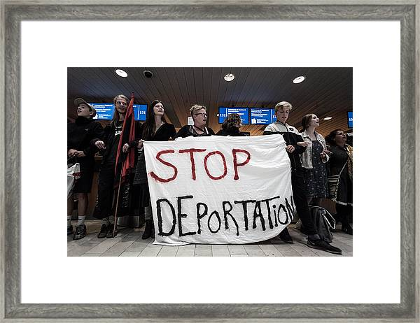 Activists Prevent Deportation Of Ugandan Asylum Seeker In Denmark Framed Print by NurPhoto