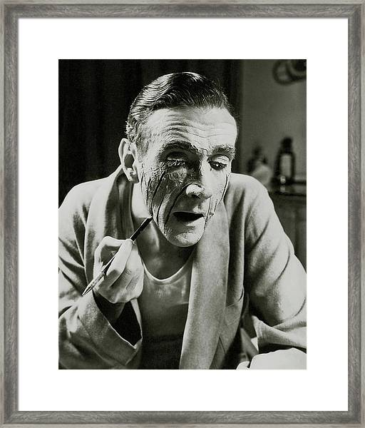 Actor Clifton Webb Applying Make-up Framed Print by Lusha Nelson