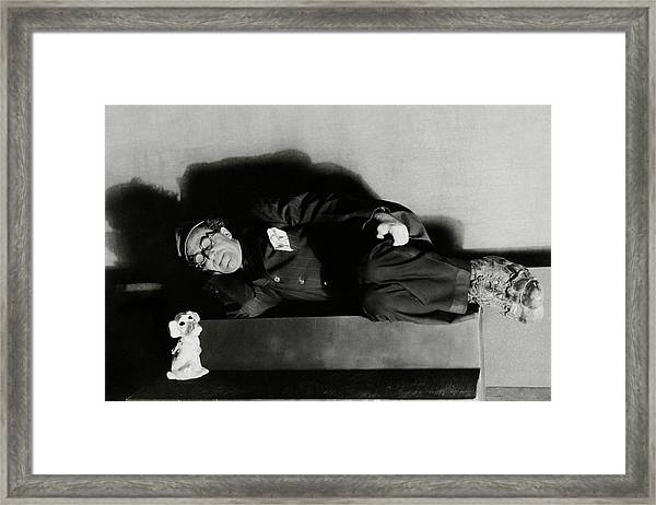 Actor Ed Wynn Lying Down On A Bench In 'the Laugh Framed Print by Florence Vandamm