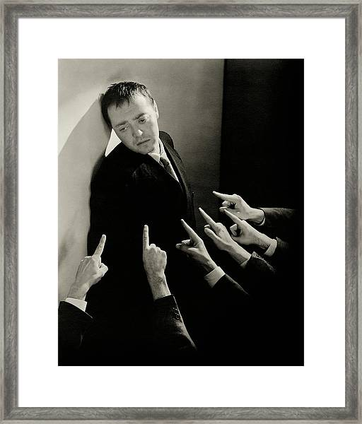 Actor Peter Lorre Posing Against A Wall Framed Print