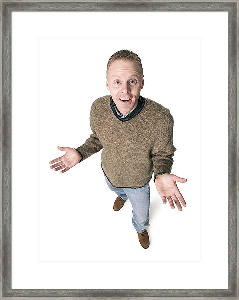 Adult Caucasian Man Dressed In Jeans And Green Sweater Gestures With His Hands Shrugs His Shoulders Framed Print by Photodisc