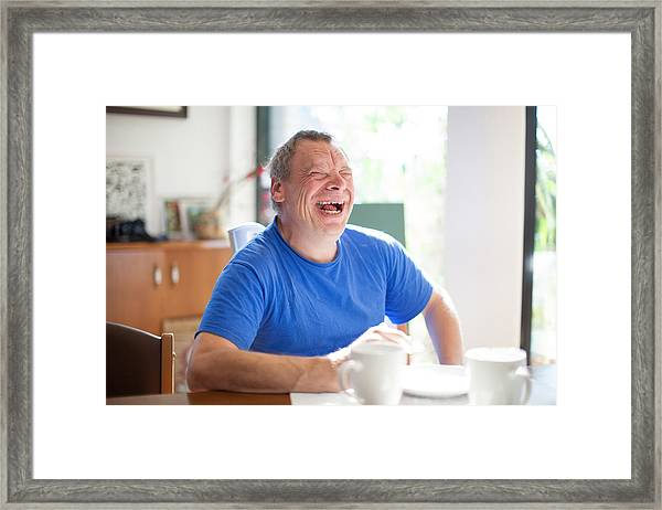 Adult Man Portrait With A Down Syndrome Framed Print by CasarsaGuru
