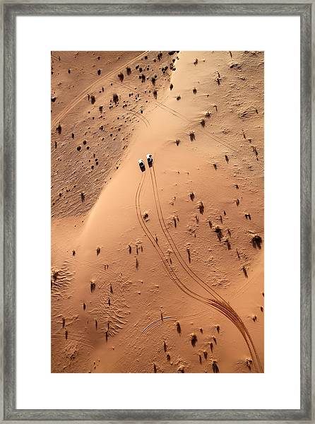 Aerial View Of Cars Driving Through Framed Print
