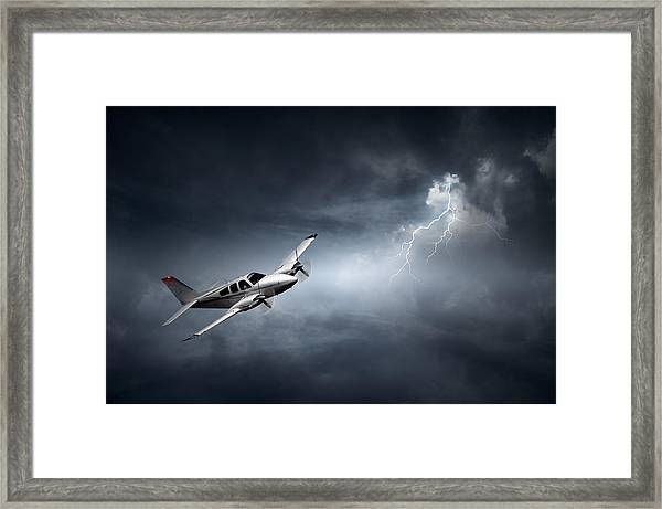 Risk - Aeroplane In Thunderstorm Framed Print