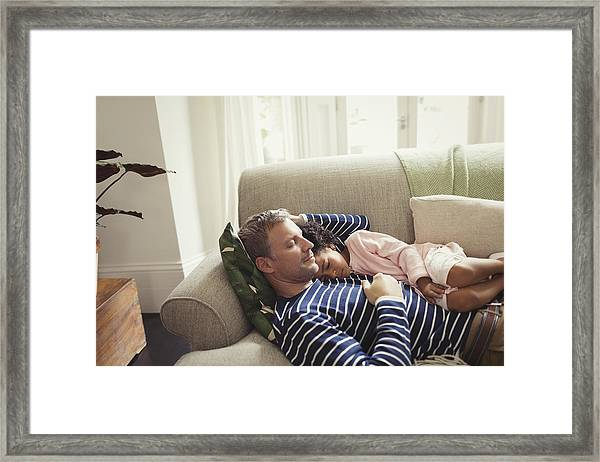 Affectionate, Serene Multi-ethnic Father And Daughter Napping On Sofa Framed Print by Caiaimage/Paul Bradbury