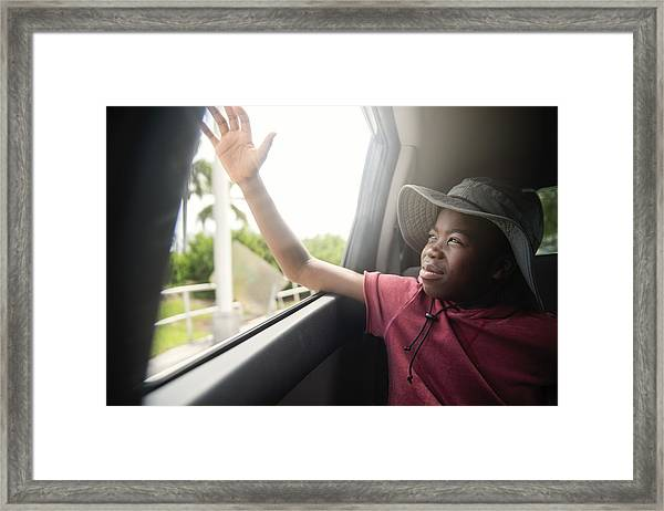 African-american Boy On The Back Seat Of A Car. Framed Print by Martinedoucet