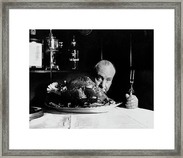 Alfred Hitchcock Looking At The Camera Framed Print
