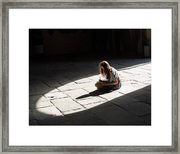 Alone In A Pool Of Light Framed Print