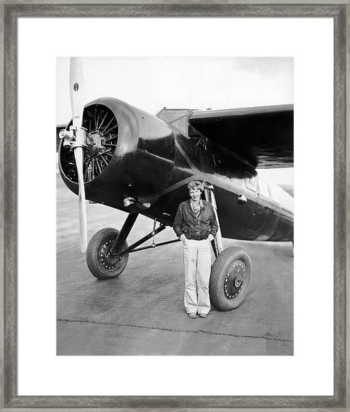 Amelia Earhart And Her Plane Framed Print