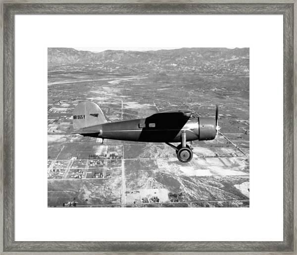 Amelia Earhart In Her Plane Framed Print
