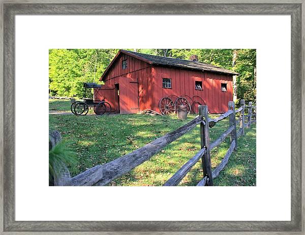 Amish Barn Along A Fenceline Framed Print
