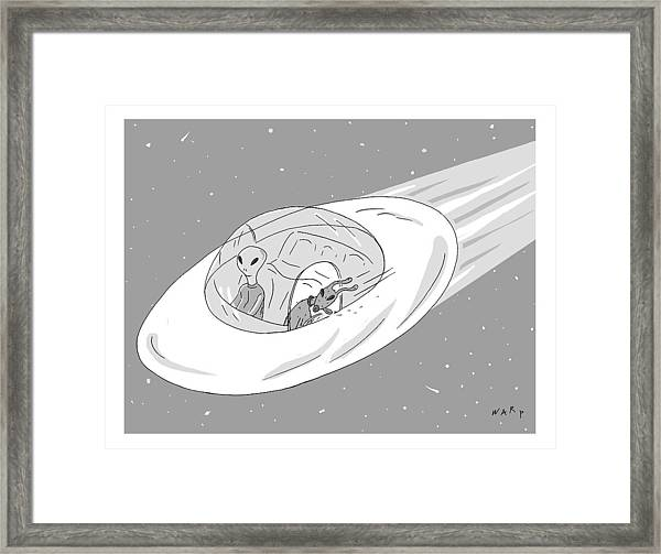 An Alien Cruises Through Space In A Flying Saucer Framed Print