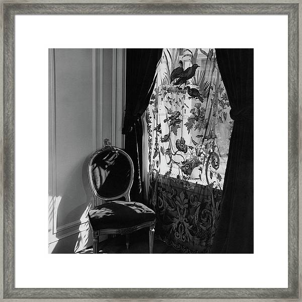 An Antique Chair By A Window Framed Print
