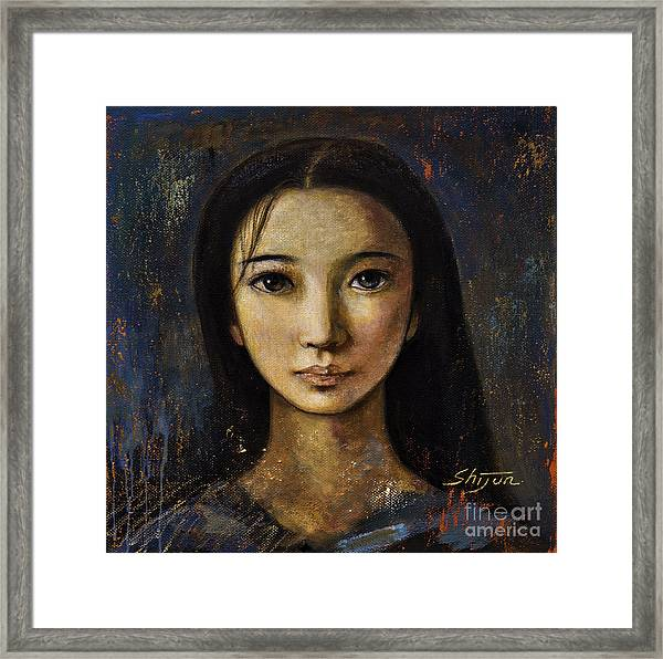 An Enigmatic Face Framed Print