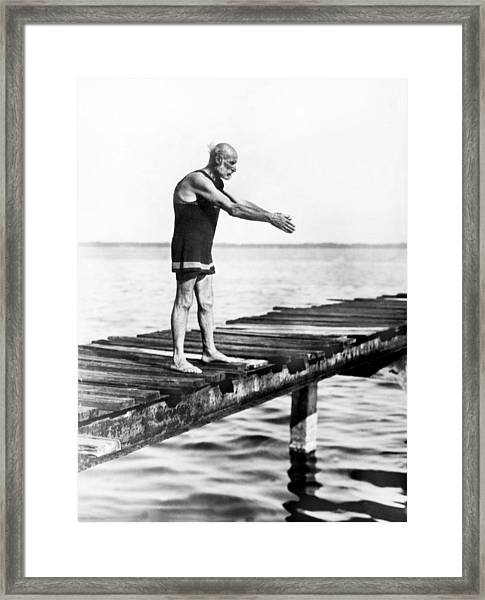 An Old Man Prepares To Dive Framed Print
