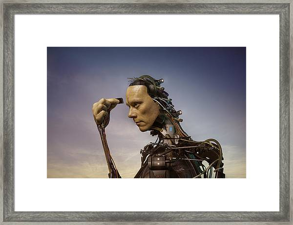 Android Robot Replacing Memory Card Framed Print by Peter Sherrard
