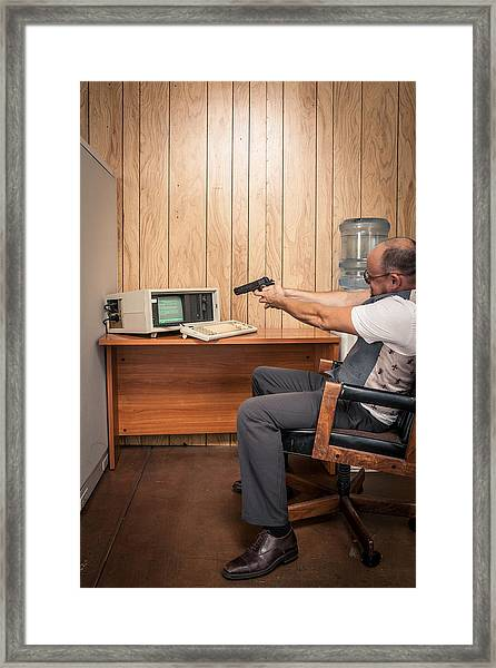 Angry Office Working Aiming Gun At Old Computer Framed Print by Sjharmon