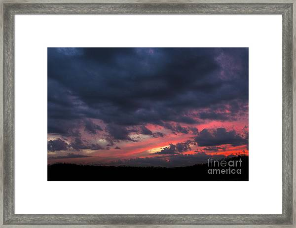 Angry Sunset Framed Print