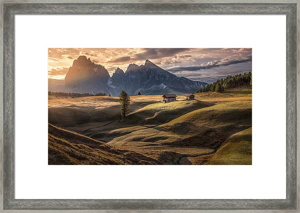 As The First Rays Warm Up The Land Framed Print