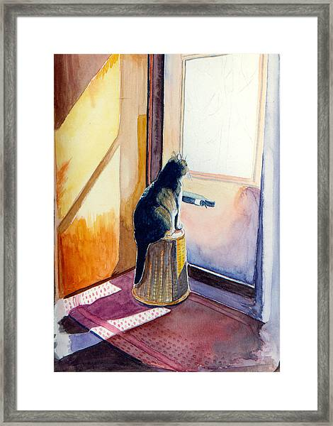 At The Door Framed Print