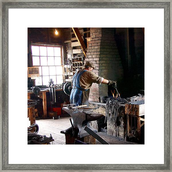 At The Forge Framed Print